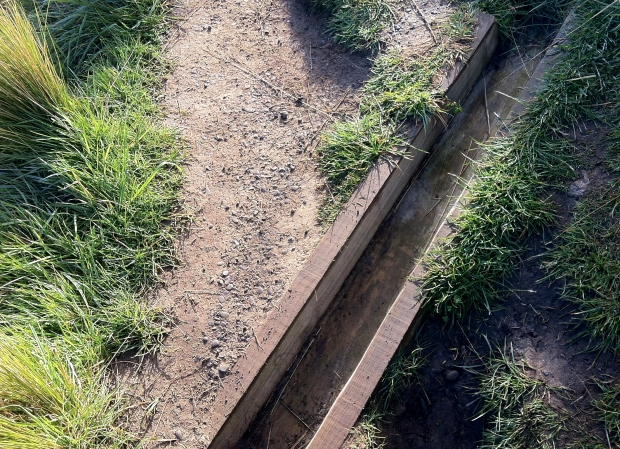 Drainage channels across the track