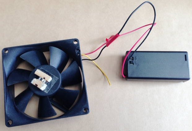 Fan with neodymium magnet and wood, connected to two AA batteries
